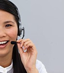 Close_up of a laughing customer service agent using headset at work