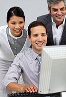 Multi_ethnic business people working together at a computer