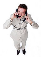 Furious businessman tangle up in phone wires isolated on a white background