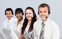 Smiling young people with a headset on working in a call center