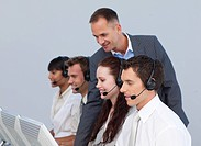Manager and multi_ethnic team working in a call center