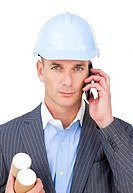 Serious male architect on phone isolated on a white background