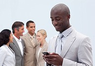 Attractive Afro_American businessman writing a message in front of his team