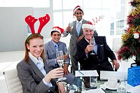 Multi_ethnic busioness team toasting with Champagne at a Christmas party in the office