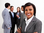 Beautiful businesswoman leading her team agaisnt white background
