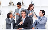 Cheerful business people toasting with Champagne to celebrate a success