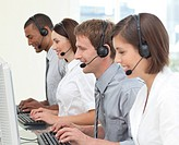 Concentrated customer service agents with headset working on in a call center