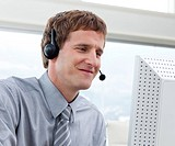Close_up of businessman working in a call center in a company