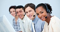 A diverse business team working in a call center with headset on
