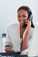 Assertive ethnic businesswoman on phone looking at the camera Business concept