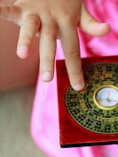 Close_up of a Chinese calendar in a child's hand