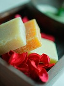 Close_up of natural soaps with rose petals