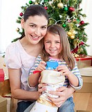 Happy mother and daughter at home at Christmas time