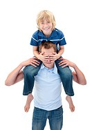 Cheerful father giving his son piggyback ride against a white background