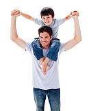 Positive father giving his son piggyback ride against a white background