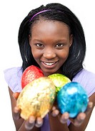 Smiling ethnic woman showing Easter eggs against a white background
