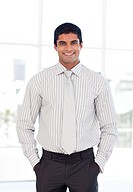 Standing businessman smiling at the camera