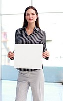 Confident woman showing a big business card in office