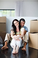 Smiling couple moving to their new house