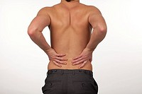 Young Man with backpain isolated agasint a white background