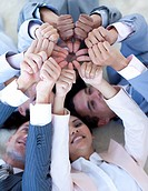 Multi_ethnic business team on floor in a circle with thumbs up