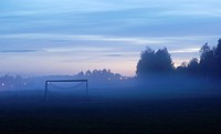 Sports field in mist. Sweden