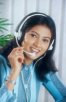 Working lady using microphone in BPO call centre MR520