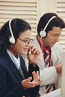 Colleagues using microphones in BPO call centre MR572,573