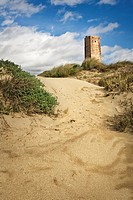Tower and dunes, Cabopino, Costa del Sol. Marbella, Malaga province, Andalusia, Spain