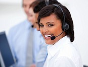 Close_up of an ethnic customer service agent and her team against a white background