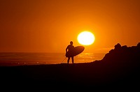 Sunset surf session at Campus Point at UCSB on the Pacific Ocean near the city of Goleta in southern Califonia USA