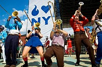 'Mucca Pazza,' a marching band from Chicago, performs at McCarren Park Pool in Brooklyn, NY