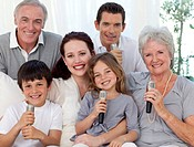 Portrait of family singing with microphones in living_room