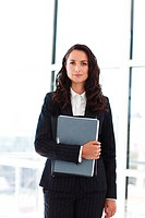 Attractive young businesswoman working in office