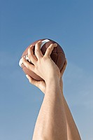 person holding rugby ball