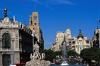 Fountain and buildings at Plaza de Cibeles under blue sky, Calle de Alcala, Madrid, Spain, Europe