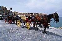 Horse drown carriages at the harbour of Chania, Crete, Greece, Europe
