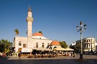 View over the Platia Eleftherias to a pavement cafe at Defterdar_Mosque, Kos_Town, Kos, Greece