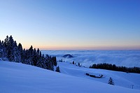 Snow_covered alpine hut above fog bank at dusk, Kampenwand, Chiemgau Alps, Chiemgau, Bavaria, Germany