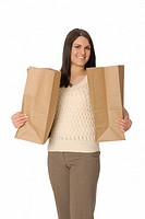 Attractive woman with two brown paper shopping bags