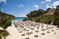 Sandy beach with sunshades at the bay of Cala Santanyi, Mallorca, Balearic Islands, Spain, Europe