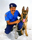 First Constable Ronnie Albert of the PNG Constabulary with his dog, Max