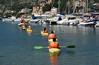 Canoeing in the marina of Puerto Soller, Port de Soller, Mallorca, Majorca, Balearic Islands, Mediterranean Sea, Spain, Europe