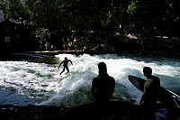 Surfers riding the Eisbach, ice brook waves, English Garden, Munich, Bavaria, Germany, Europe