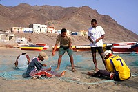 Fishermen repairing nets on the beach of Sao Pedro, Sao Vicente, Cape Verde Islands, Africa