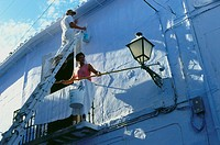Whitewashing a house in Frigliana, white village, Province Malaga, Andalusia, Spain