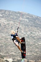 Young man on kiteboard jumping, Prassionisi Beach, Prassionisi, Rhodes, Greece