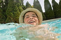 Boy wearing hat in swimming pool