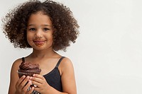 Girl with chocolate cupcake
