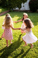 Young girls playing ring around the rosie